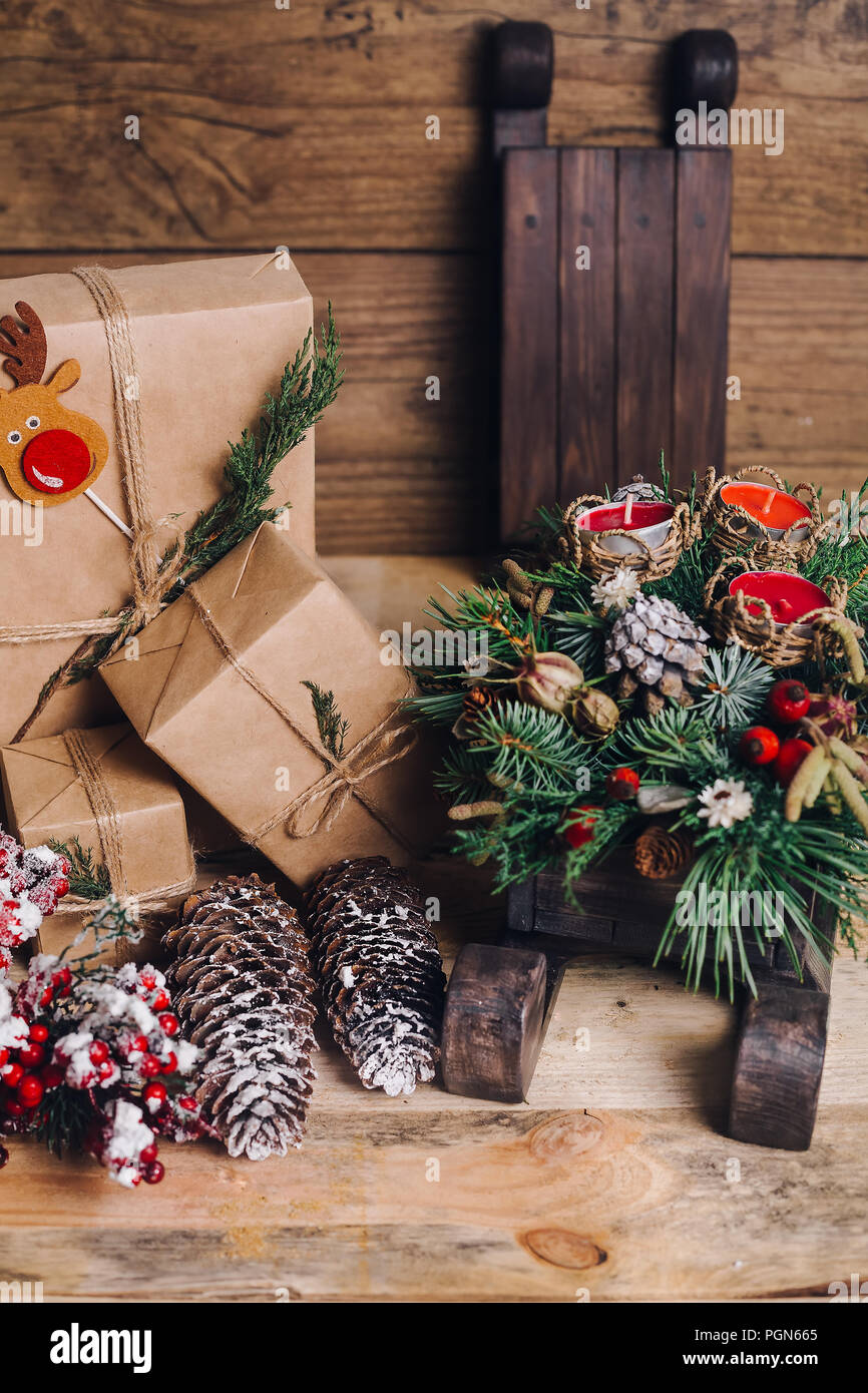 christmas gifts with boxes on wooden background vintage style closeup selective focus toy bear sled christmas concept - Vintage Sled Christmas Decoration