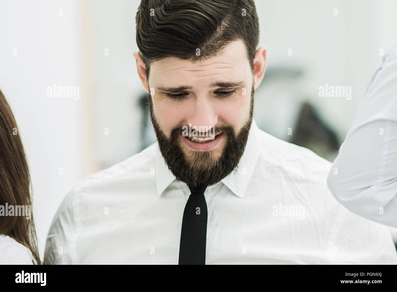 portrait of a successful Manager in the workplace in the office - Stock Image