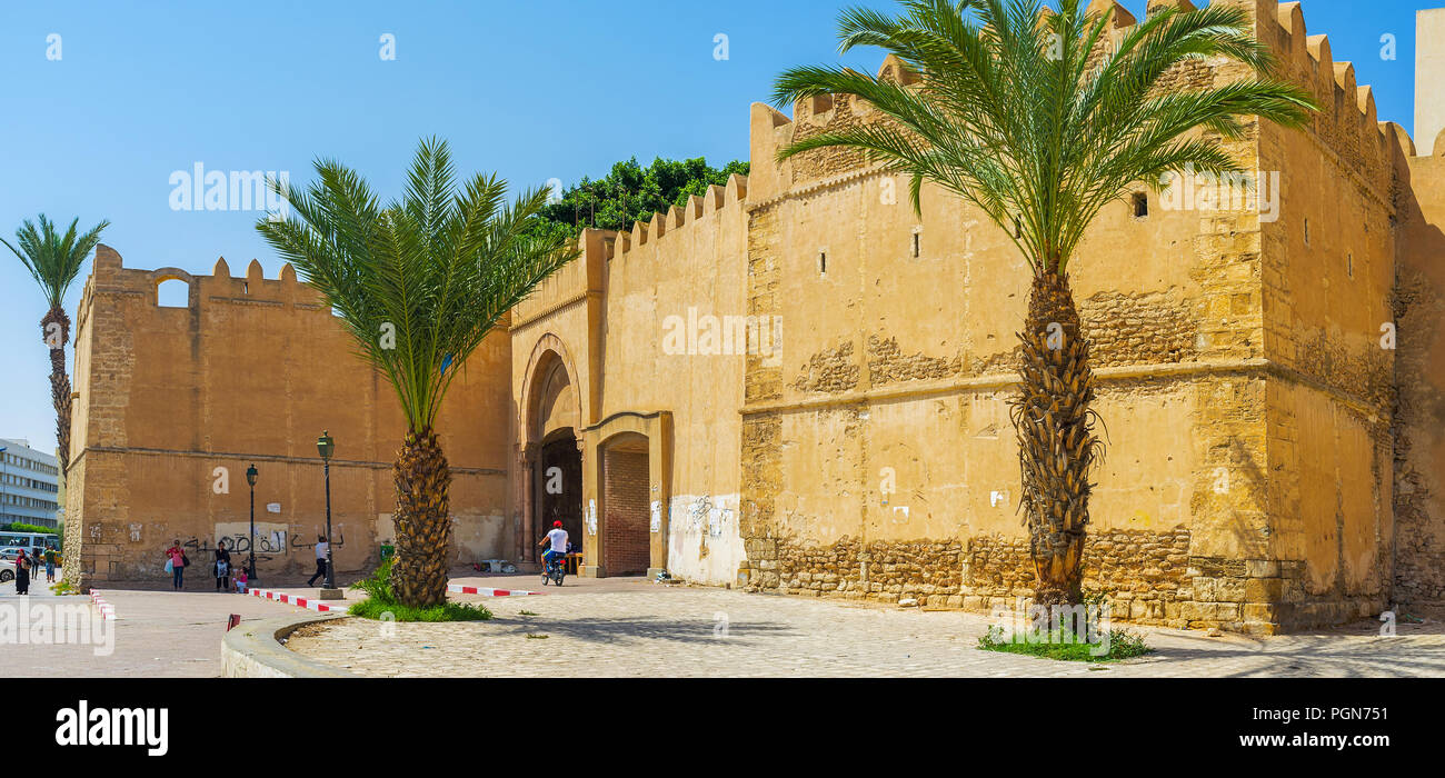 SFAX, TUNISIA - SEPTEMBER 3, 2015: Panorama of the fortress with massive walls, bastions and the gate, leading to Medina, on September 3 in Sfax. - Stock Image