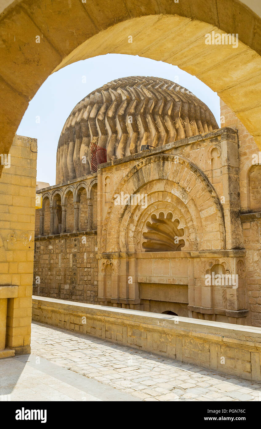 The carved zigzag cupola and relief gateway of medieval Kalat El Koubba - the funduq (caravanserai, inn), hidden in maze of Medina streets, Sousse, Tu - Stock Image