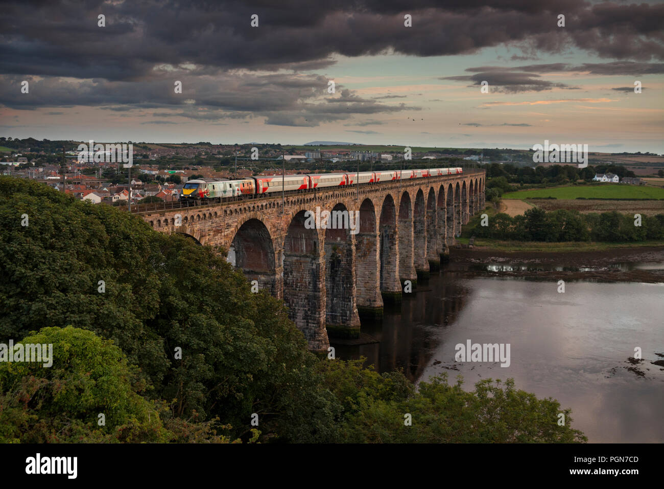 London North Eastern railway  ( LNER ) class 91 locomotive 91111 For the Fallen crossing the Royal border bridge, Berwick upon Tweed - Stock Image