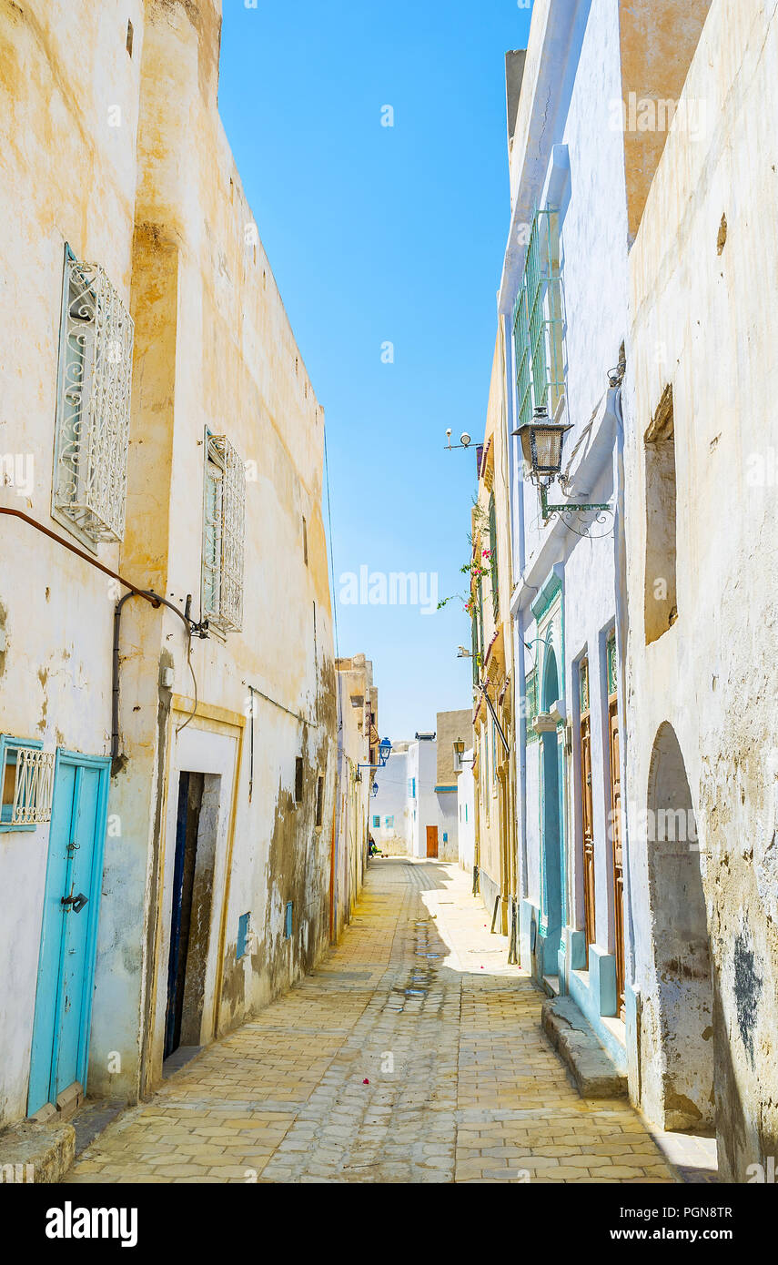 The daily walk in old Medina - one of the main fine preserved city landmarks, the tilted walls of medieval residential houses make the street curved,  - Stock Image