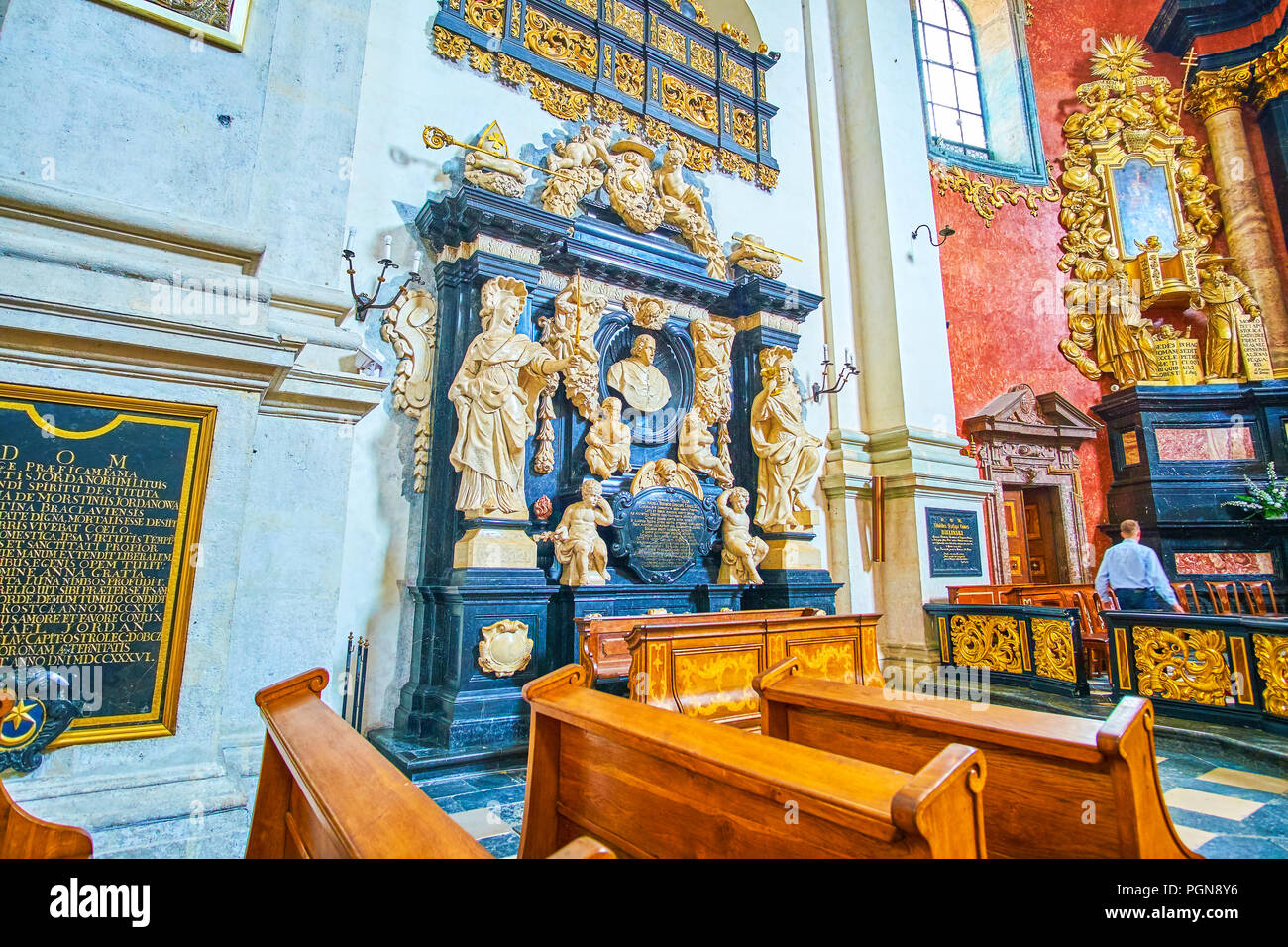 KRAKOW, POLAND - JUNE 11, 2018: Imbedded tombstone of Bishop Andrzej Trzebicki richly decorated with carved stucco sculptures, St Peter and Paul Churc - Stock Image