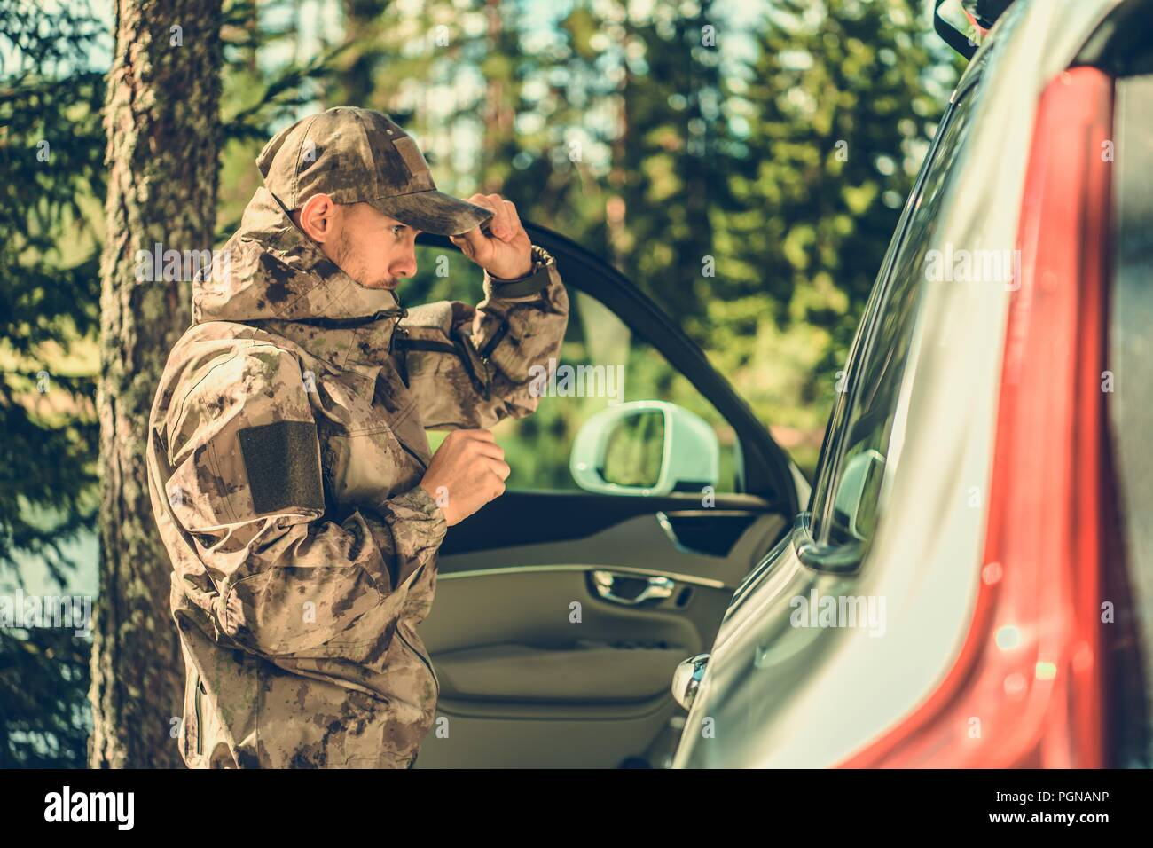 Caucasian Forestry Worker Making Conversation with Driver Who Illegally Entered Closed Section of the Forest. - Stock Image