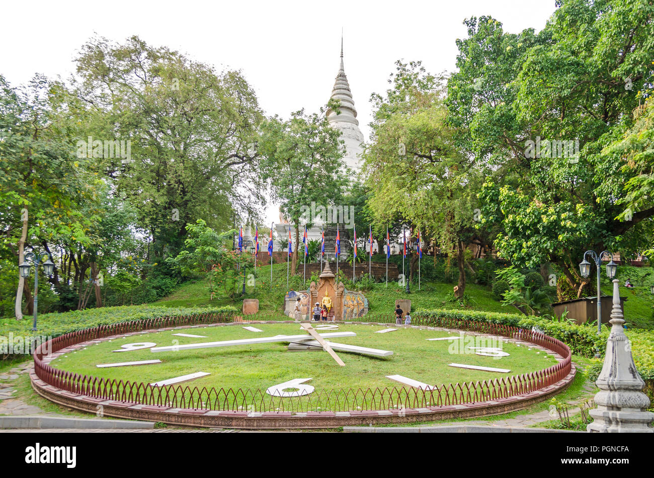 Phnom Penh, Cambodia - April 8, 2018: The main stupa and garden of Wat Phnom (Mountain Pagoda), the central point of Phnom Penh, and the statue of Kin Stock Photo