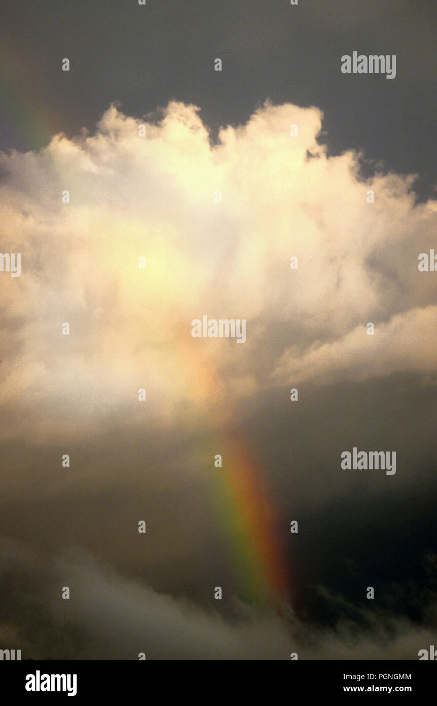 Rainbow and clouds - Stock Image