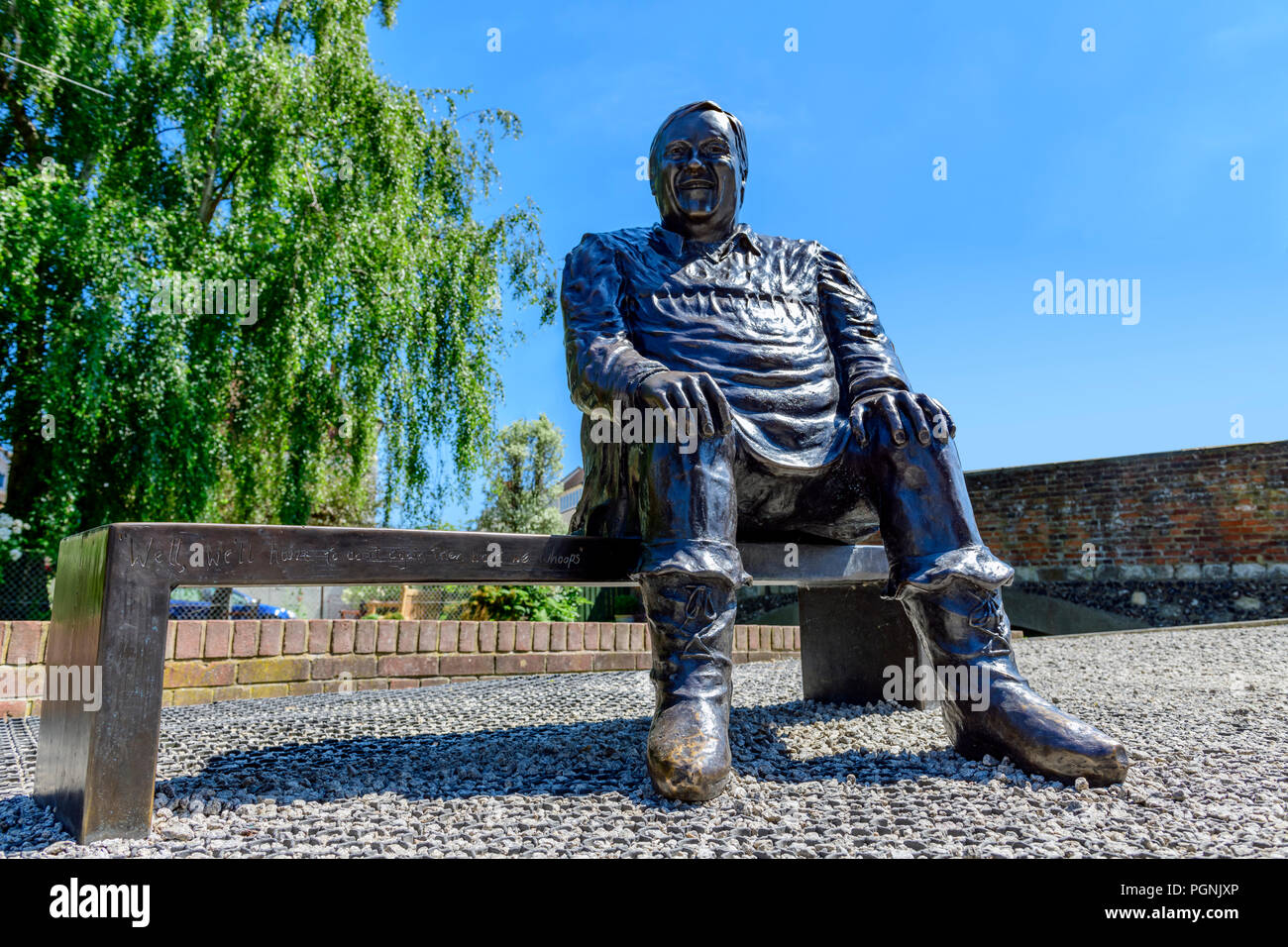 Bronze statue of Dave Lee the famous pantomime dame outside the Marlowe theatre Canterbury Stock Photo