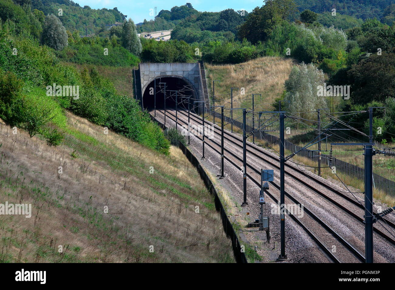 The high speed line through Kent alongside the M20 in Kent with double line and Overhead Line Equipment for power to traction untis running here. Stock Photo