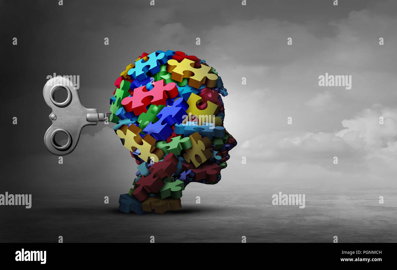 Autism therapy concept as a group of puzzle pieces shaped as a head of a child as an autistic icon for mental disorder idea. - Stock Image