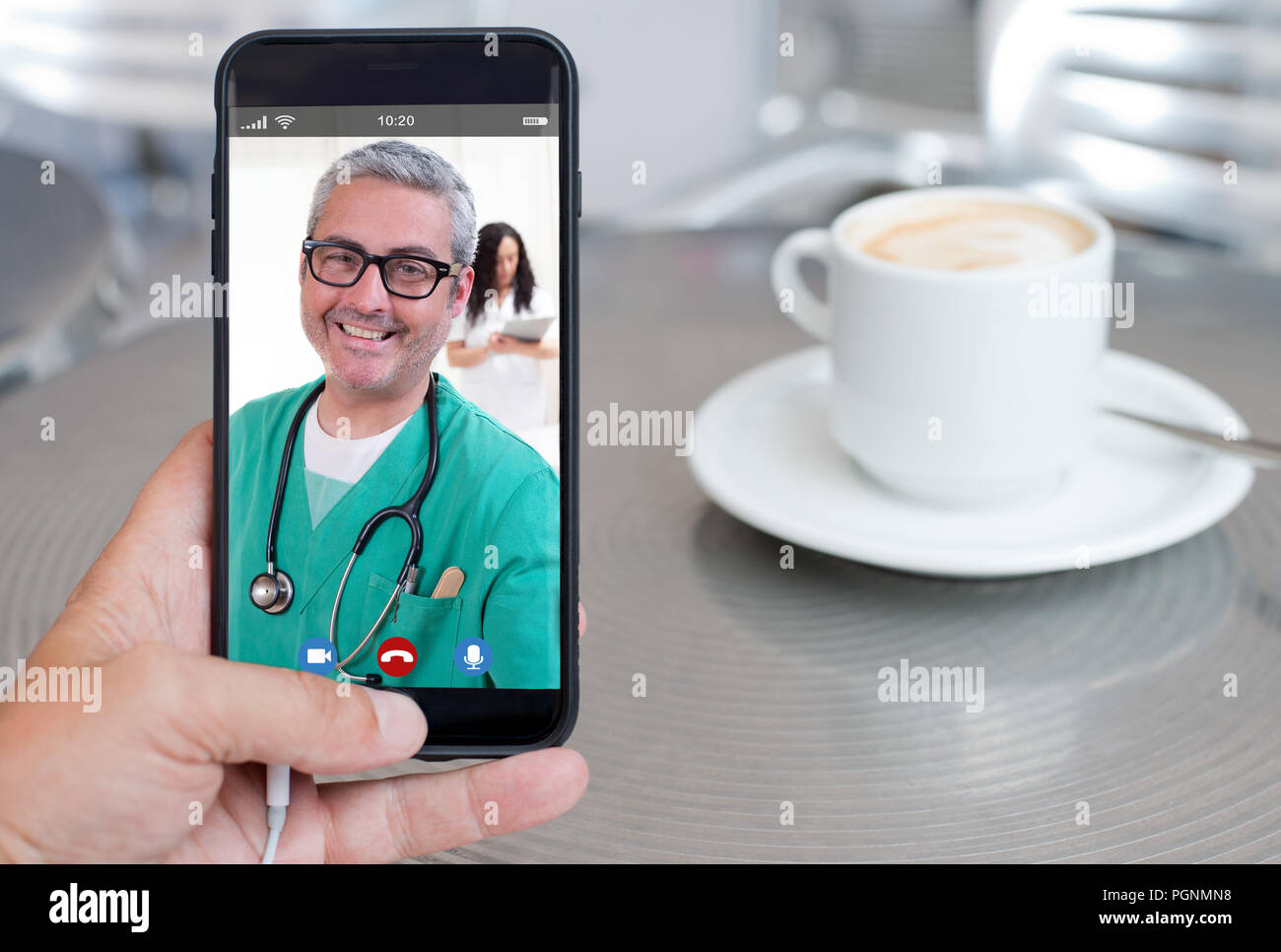 smartphone video call to talk with your doctor drinking coffee - Stock Image