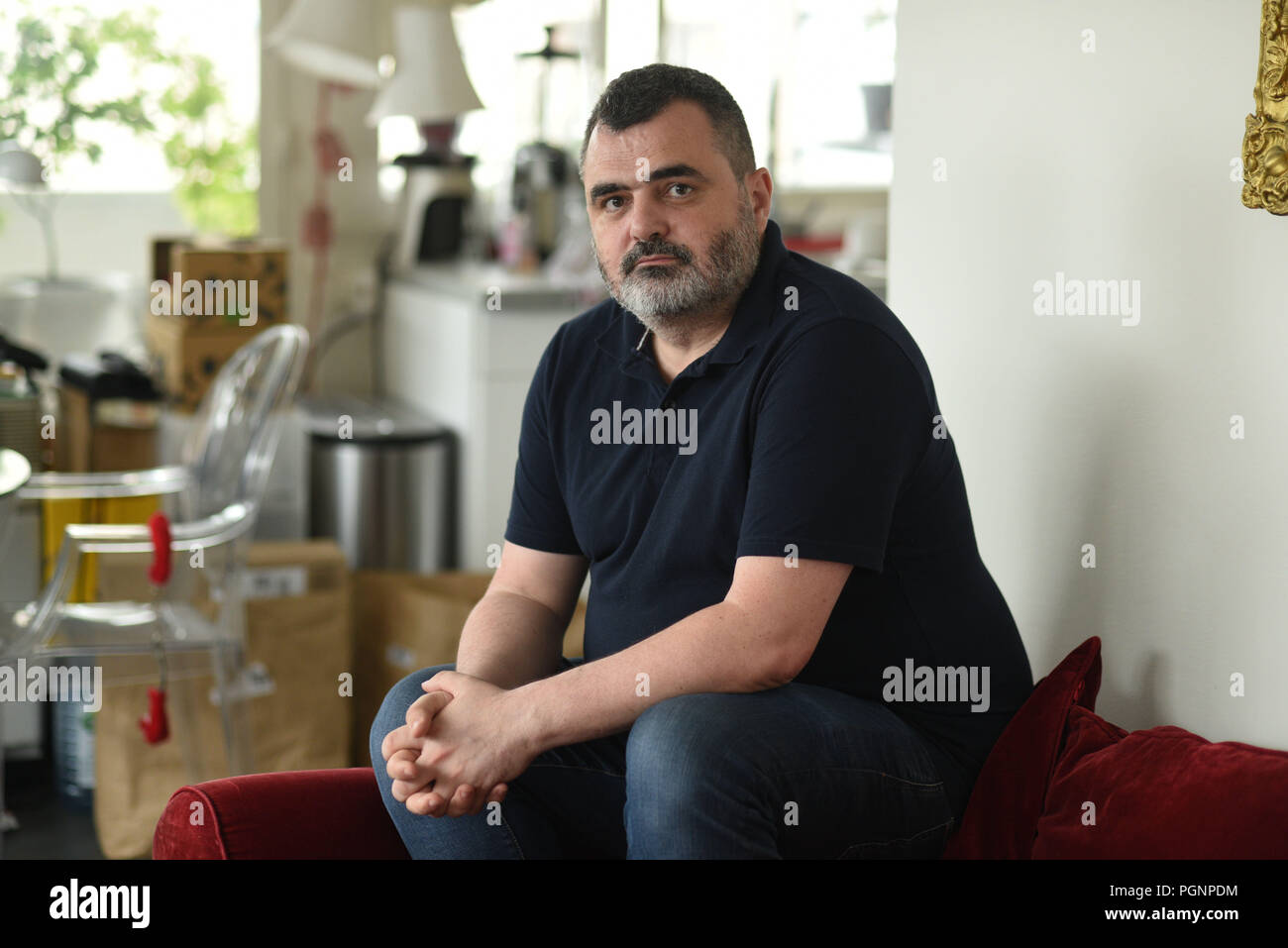 "June 5, 2018 - Paris, France: Portrait of Frederic Desnard, a French employee who took his former employer to court over a ""bore-out"" case and won. He is pictured at his home in Paris, where he spends most of his time since being fired in 2014. Portrait de Frederic Desnard, le premier salarie indemnise dans un cas de ""bore-out"". L'ancien salarie d'Interparfums a fait condamne son ex-employeur pour avoir manque de travail suite a une crise d'epylepsie. *** FRANCE OUT / NO SALES TO FRENCH MEDIA *** Stock Photo"