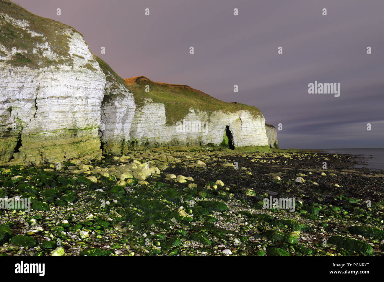 Cliffs & Caves at North Landing in Flamborough at night on the North Yorkshire Coastline Stock Photo