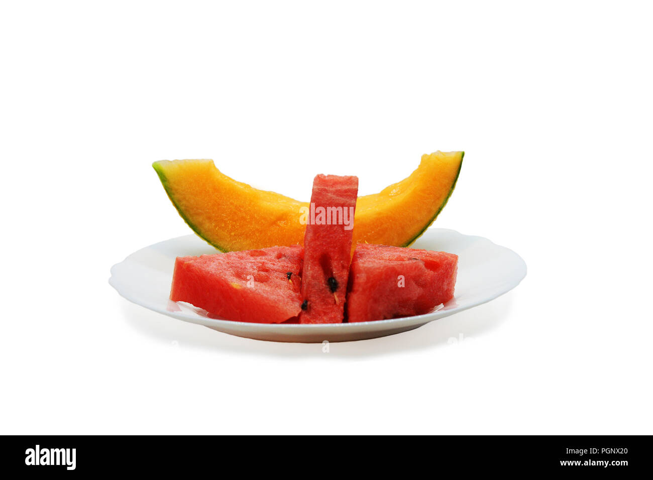 Slices of honeydew melon and watermelon isolated on white plate Stock Photo