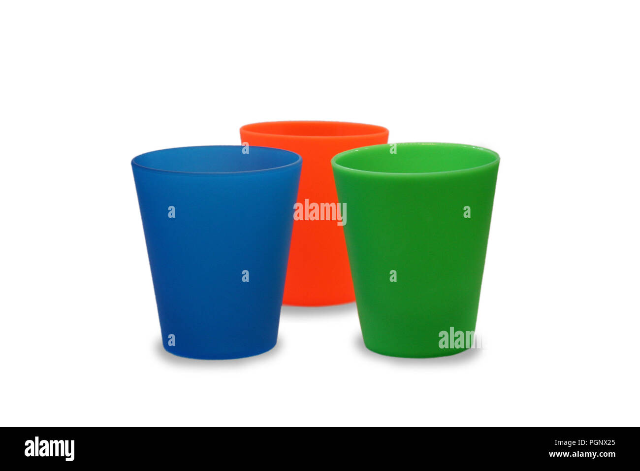 Multicolor plastic glasses, cups blue orange green on isolated white background Stock Photo