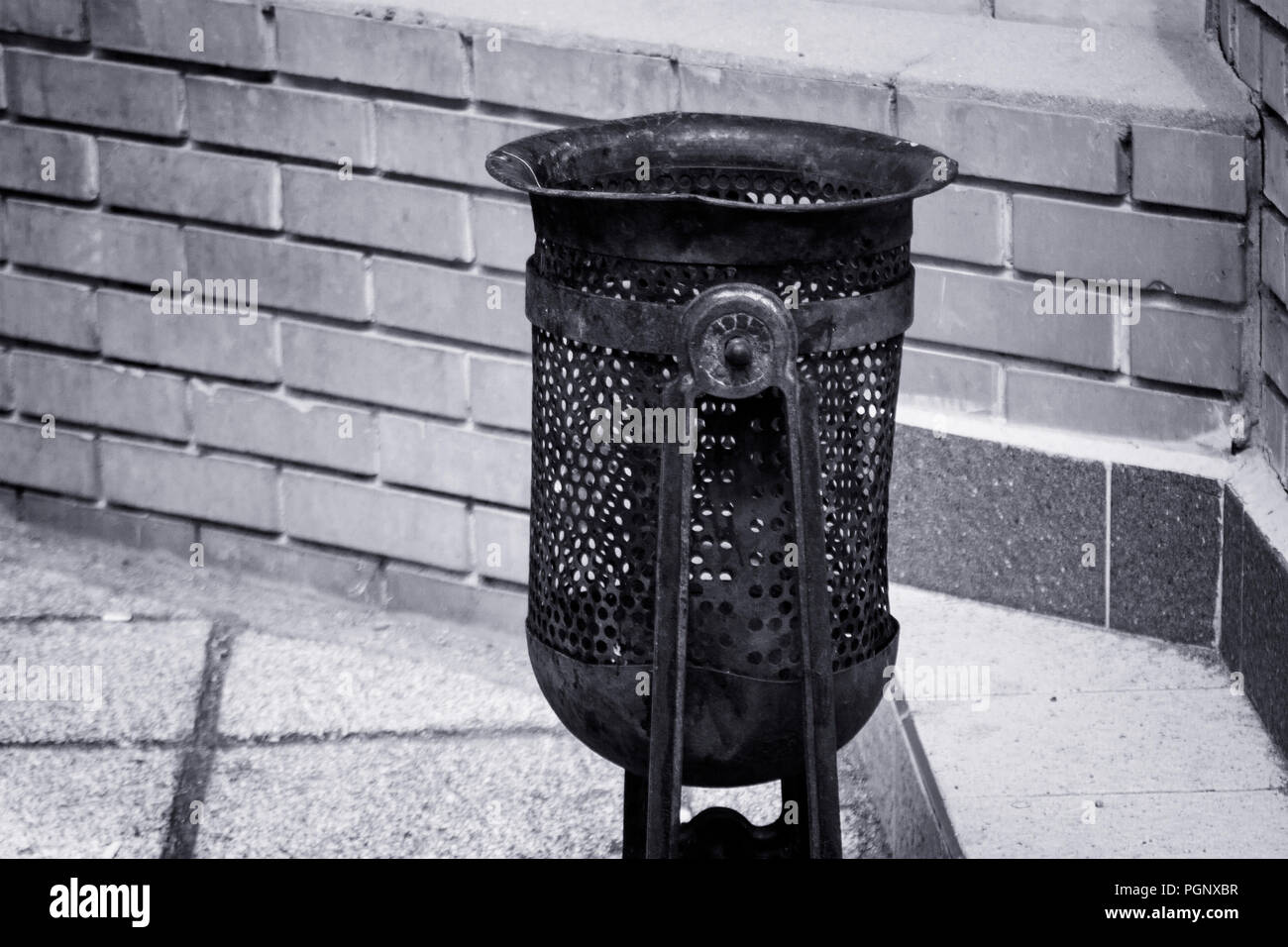 Dustbin on the street in black and white Stock Photo