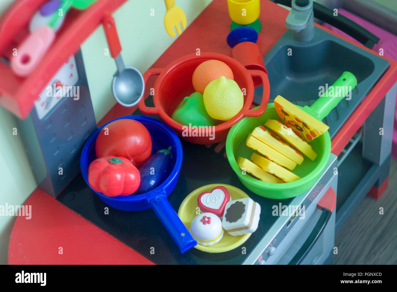 Budapest, Hungary - 07/30/2018: Girl's plastic kitchen for playing with various colors in the room. Stock Photo