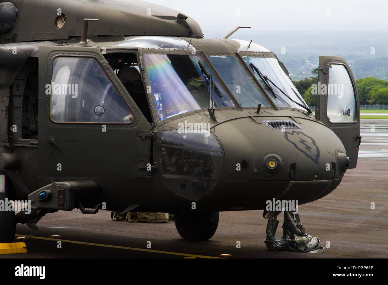 Soldiers from UH-60 Black Hawk flight crews, 25th Combat Aviation Brigade, 25th Infantry Division, Hawaii, prepare to provide Department of Defense support missions to the Federal Emergency Management Agency as part of Joint Task Force 5-0. This task force was established to respond to the effects of Hurricane Lane on the state of Hawaii.     Local authorities and the State of Hawaii, through JTF 5-0, requested HH-60M Black Hawk helicopters with hoist capability to assist local authorities with recovery operations on the Isle of Hawaii.    JTF 5-0 is a joint task force led by a dual status com - Stock Image