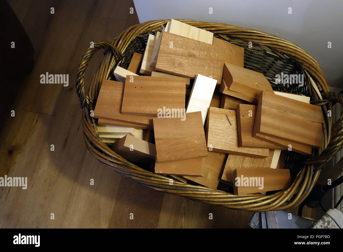 Basket of hardwood off cuts of wood ready for the log fire Stock Photo
