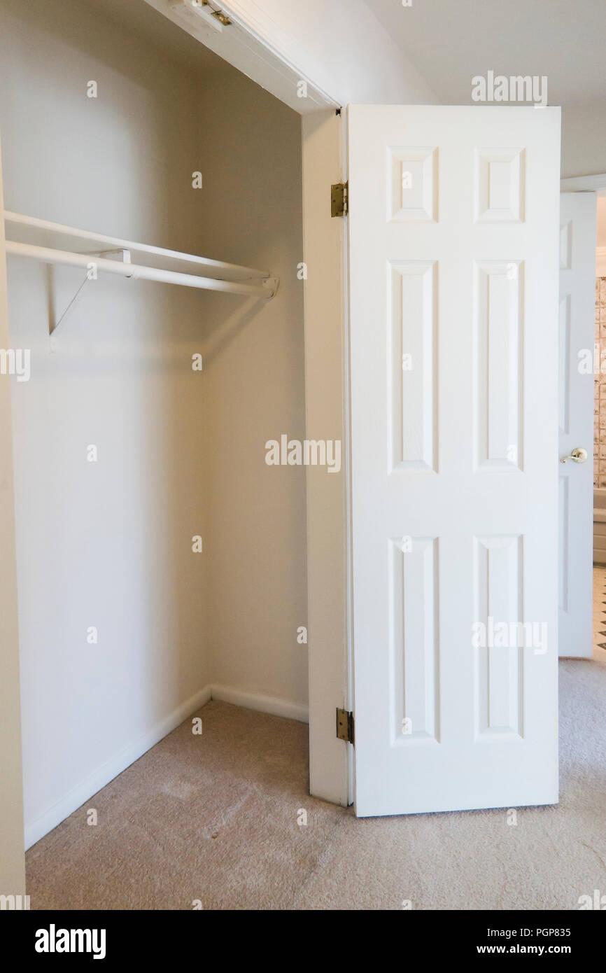 Closet in a small condominium unit painted in white - USA - Stock Image