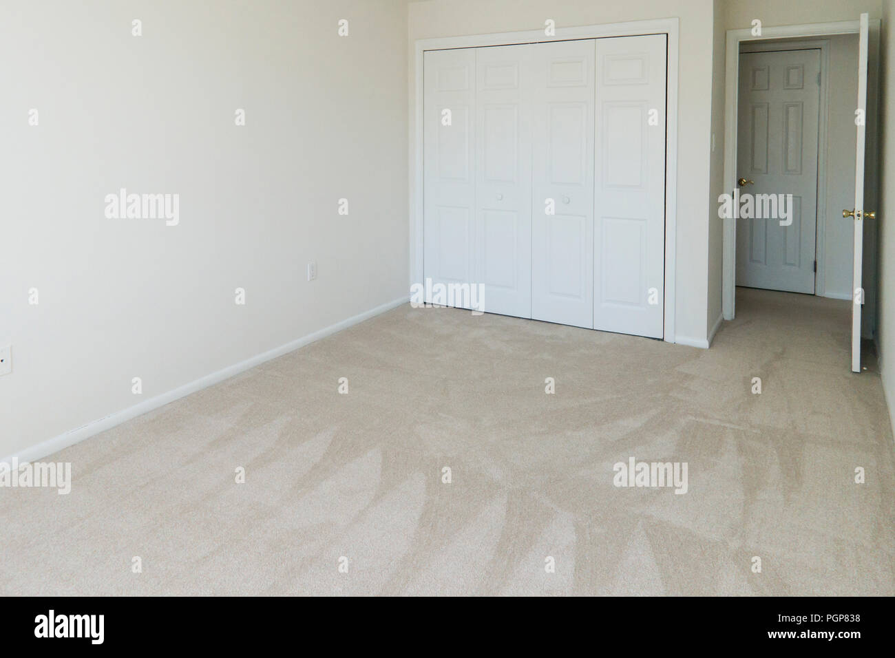Small Empty Carpeted Bedroom In A Condominium Unit Usa Stock Photo