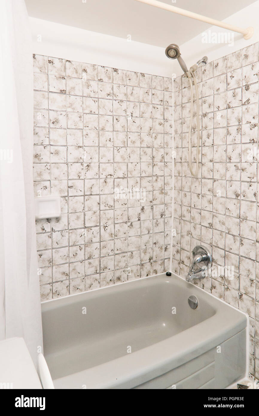 Small shower and tub in condominium unit - USA Stock Photo ...