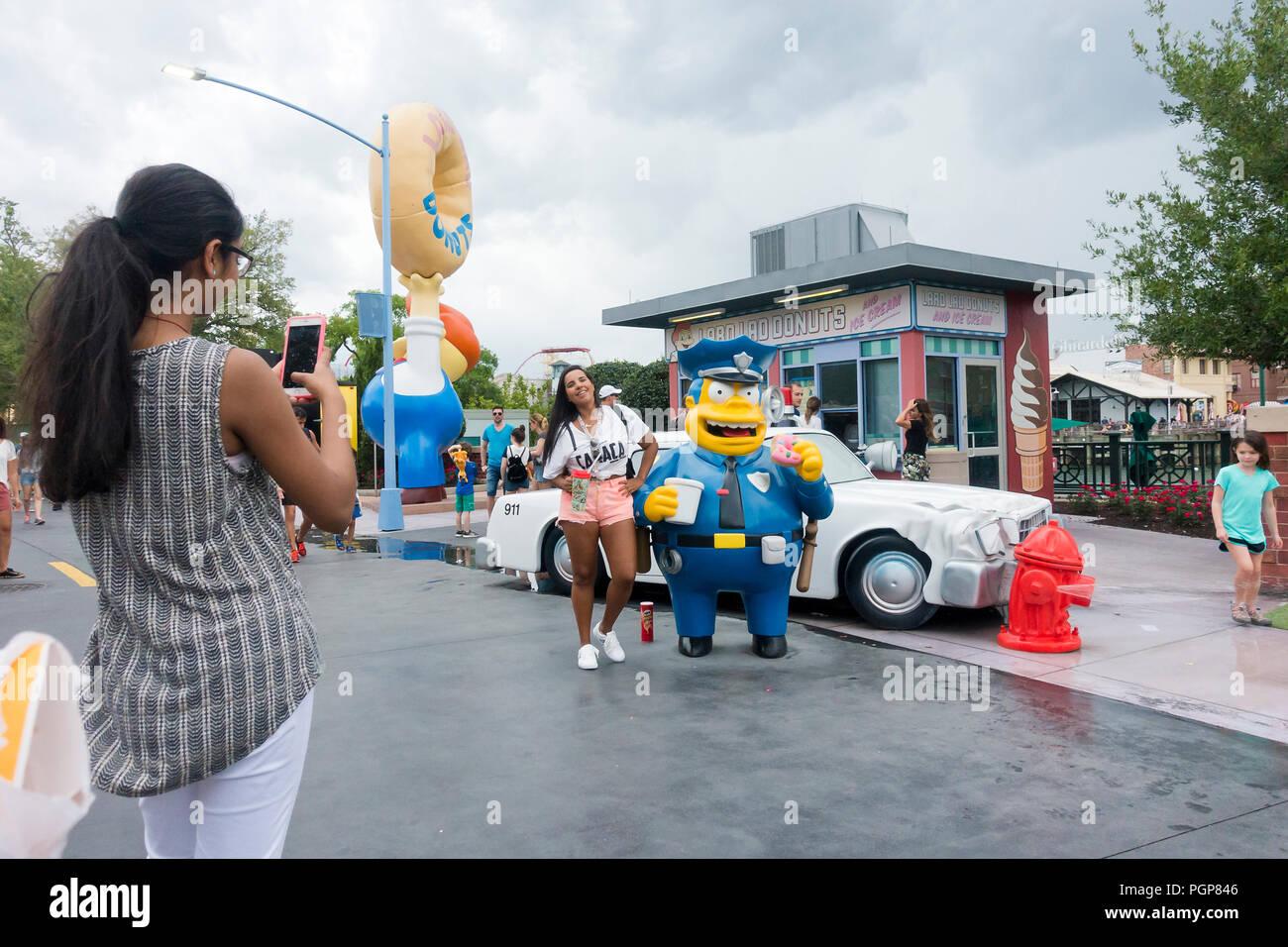 Woman taking a picture at Springfield USA, Universal Studios Florida - Orlando, Florida USA - Stock Image