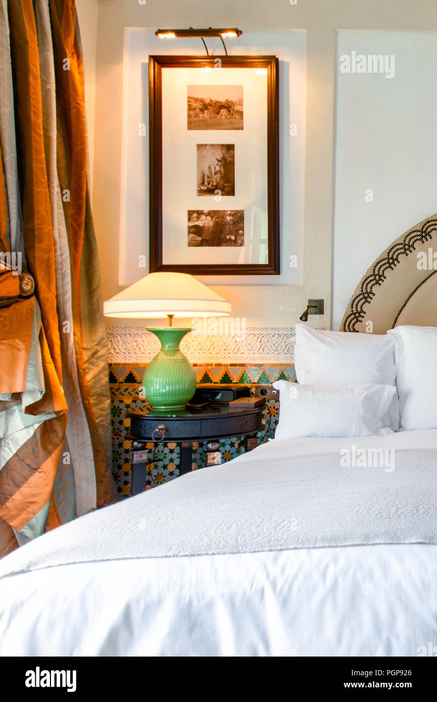 Luxury bedroom Moroccan style with white linens and silk ...