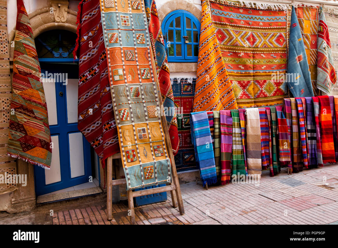 Moroccan Shop With Colorful Rugs And Carpets On Display Outside
