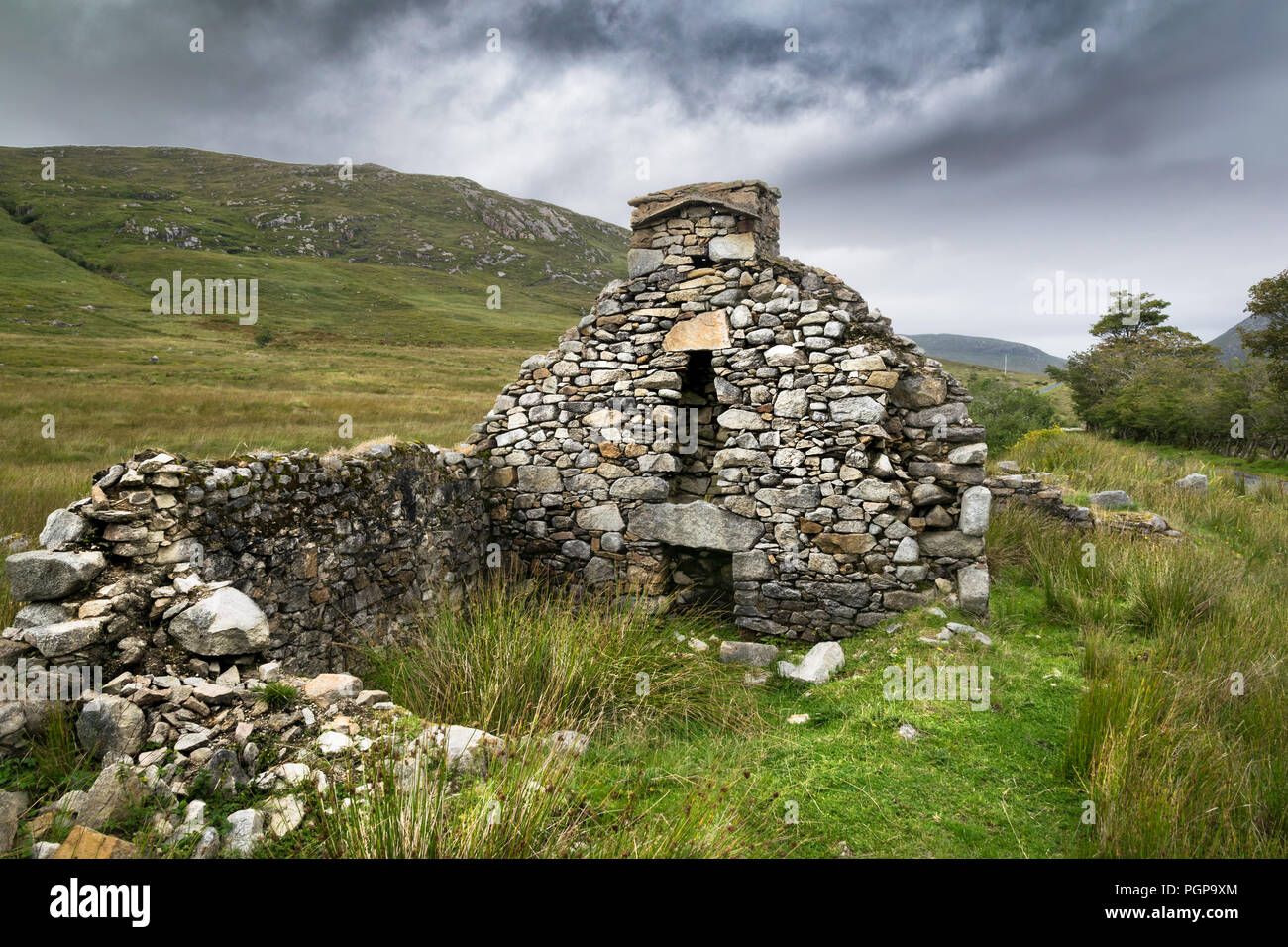 This a picture of the ruins of a Famine cottage in Donegal Ireland. this was one of many houses in an abondon village in an isolated part of the mount - Stock Image