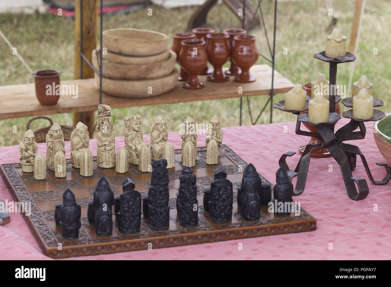 Medieval chess set on a banquet table Stock Photo