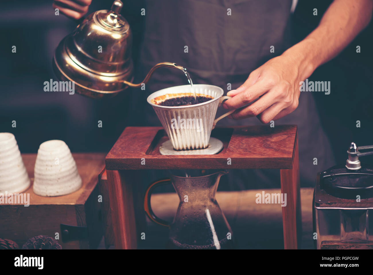 Drip brewing, filtered coffee, or pour-over is a method which involves pouring water over roasted, ground coffee beans contained in a filter. - Stock Image
