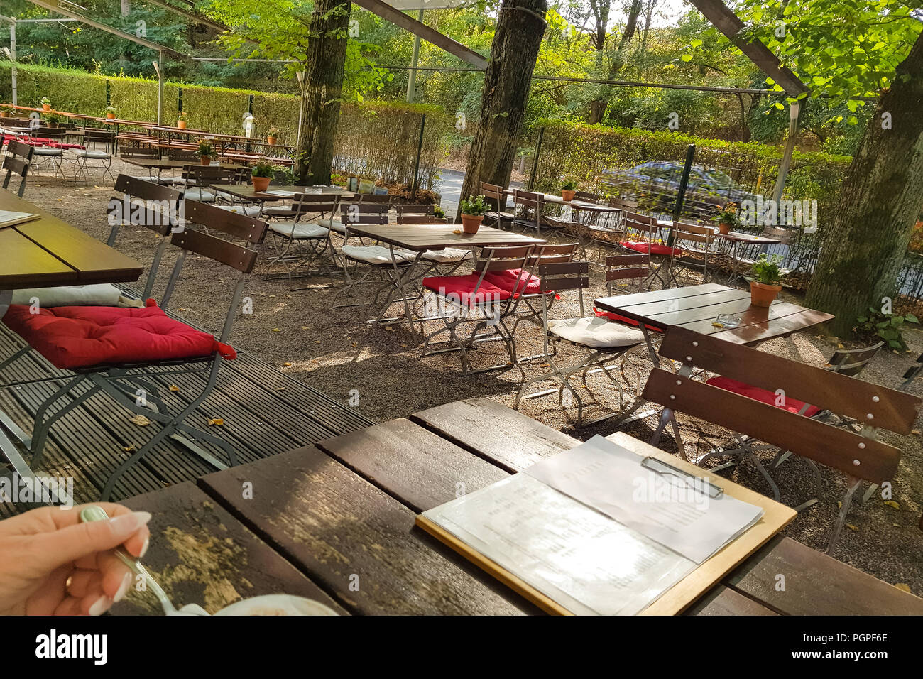 A large and traditional beer garden in Munich. Popular with locals and tourists. - Stock Image