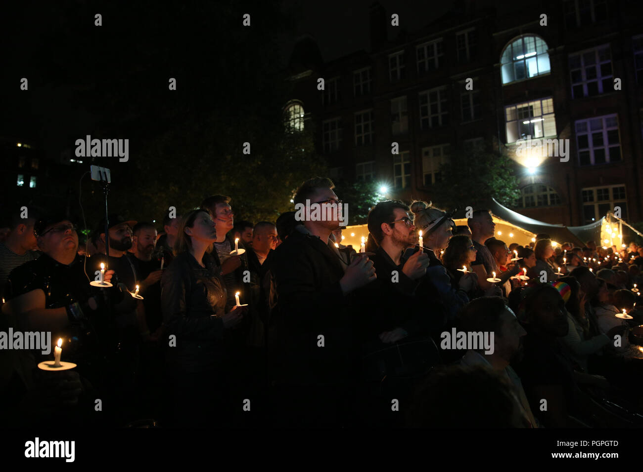 Manchester, UK. 27th Aug 2018. Candlelight vigil to remember those who have lost their lives or are living with HIV at Pride, Sackville Gardens, Manchester, 27th August, 2018 (C)Barbara Cook/Alamy Live News - Stock Image