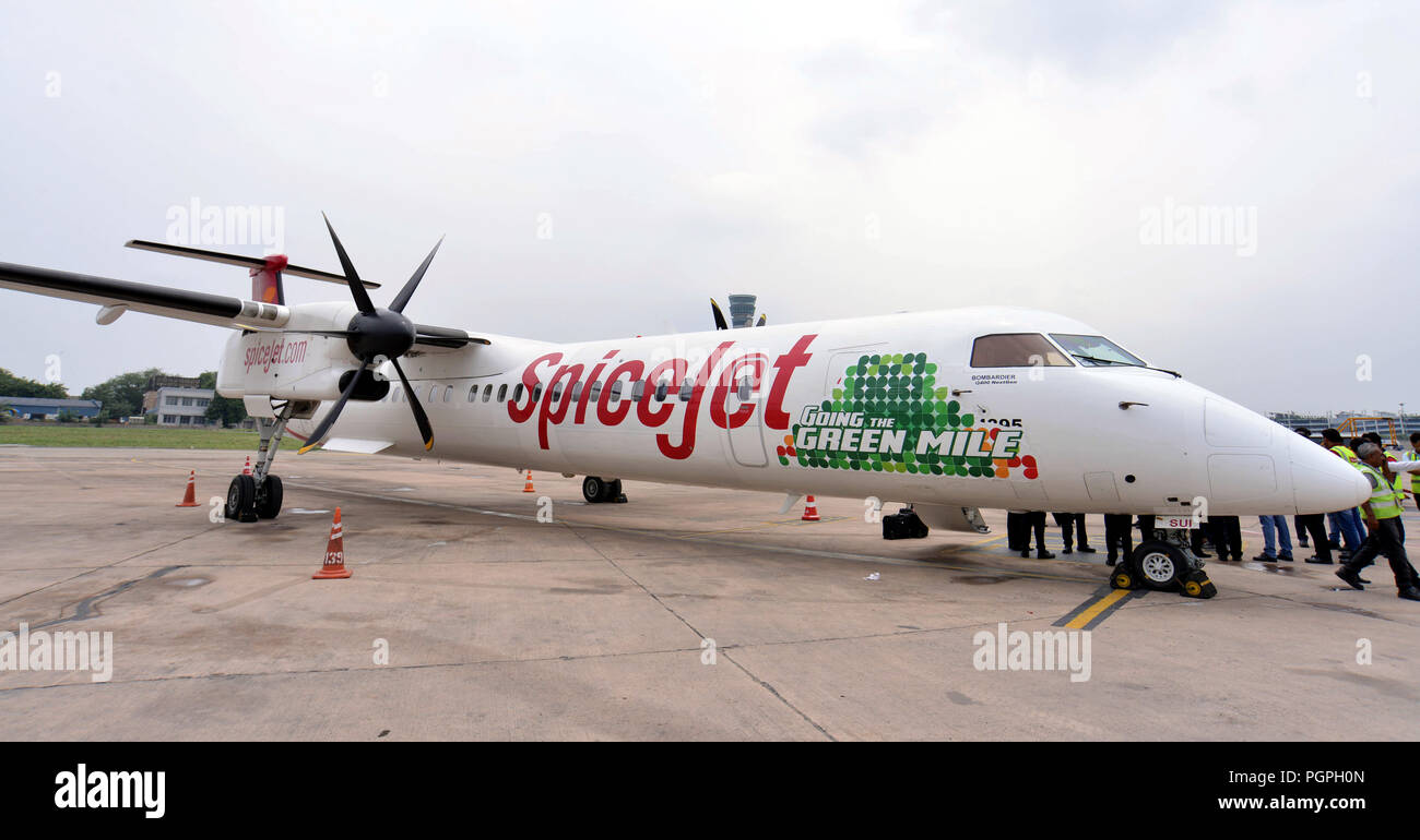 New Delhi, India. 27th Aug, 2018. The 72-seat Bombardier Q400 turboprop aircraft, powered by a mix of biofuel and air turbine fuel, is seen at Delhi Airport in New Delhi, India, Aug. 27, 2018. India's first biofuel-powered plane aimed at cutting down air travel costs was flight-tested Monday. Credit: Partha Sarkar/Xinhua/Alamy Live News - Stock Image