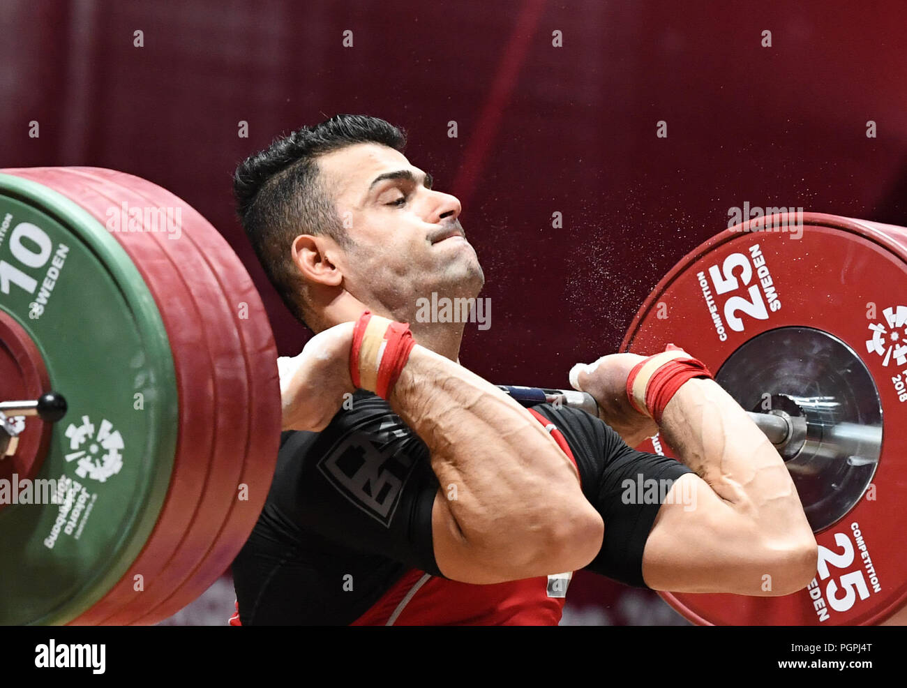 (180828) -- JAKARTA, Aug. 28, 2018 (Xinhua) -- Iraqi Safaa Rashid Mohmood Aljumaili competes during the men's 85kg event of weightlifting at the 18th Asian Games in Jakarta, Indonesia, Aug. 24, 2018. Worldwide sports are a means to promote peace, but the people who engage in sports do not always live in peaceful environments. The Syrian civil war has raged on for years, the peace process in Afghanistan is still encountering roadblocks, and Iraq is still turbulent. All of these places have sent athletes to the ongoing 2018 Asian Games. When Safaa Rashid Mohmood Aljumaili clinched the firs - Stock Image
