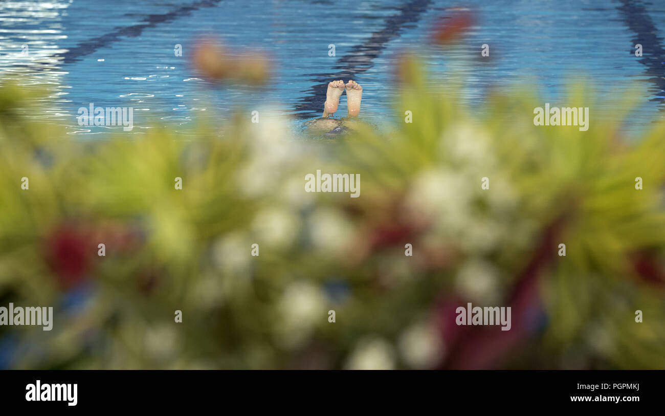 (180828) -- JAKARTA, Aug. 28, 2018 (Xinhua) -- Yekaterina Nemich and Alexandra Nemich of Kazakhstan compete during the Artistic Swimming Women's Duets contest at the 18th Asian Games in Jakarta, Indonesia, Aug. 28, 2018. (Xinhua/Fei Maohua) - Stock Image