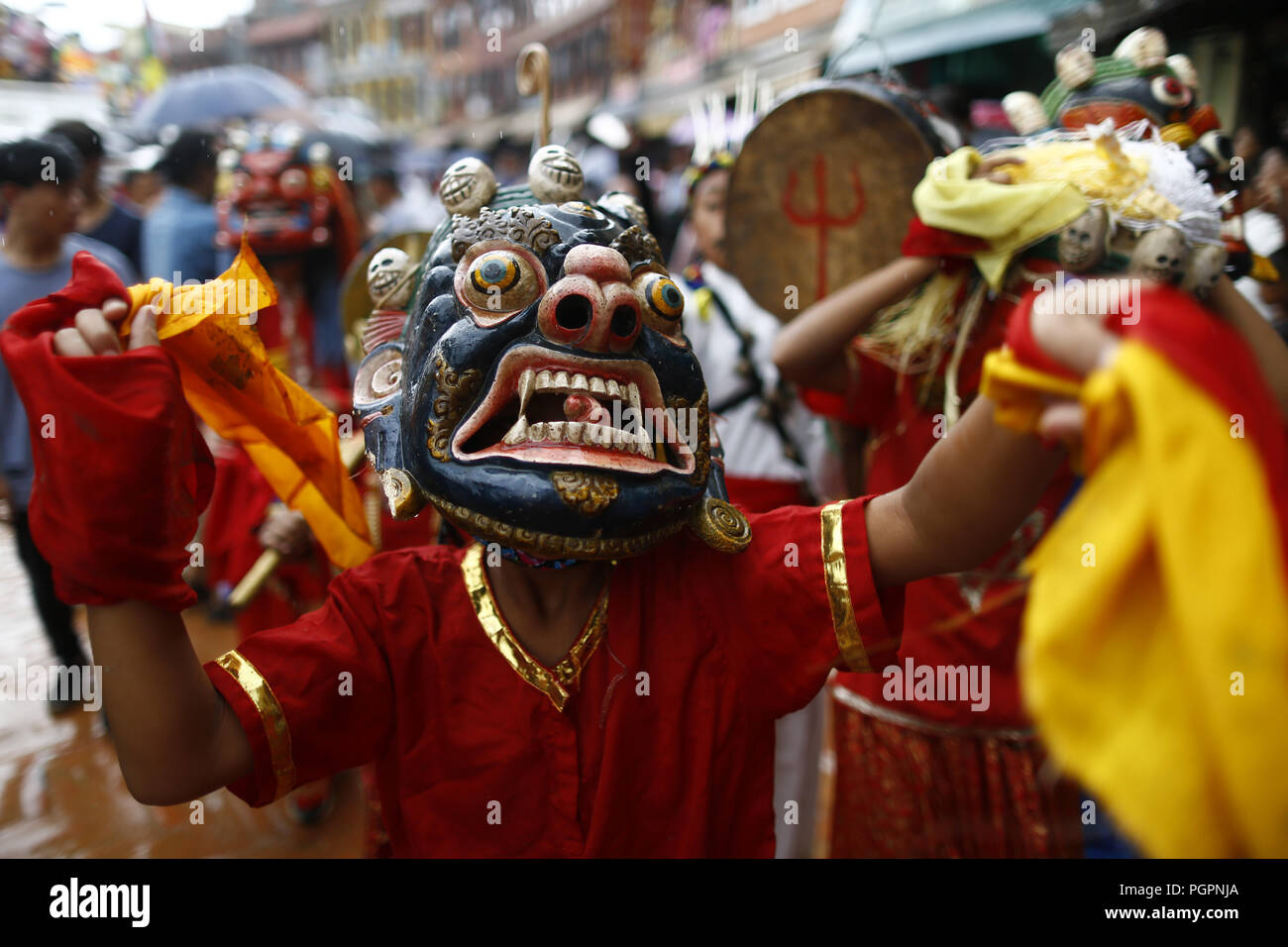 Kathmandu, Nepal. 28th Aug, 2018. A person dressed in various attire take part in a parade during Ropai festival to commemorate the departed at Boudhanath Stupa in Kathmandu, Nepal on Tuesday, August 28, 2018. Credit: Skanda Gautam/ZUMA Wire/Alamy Live News - Stock Image