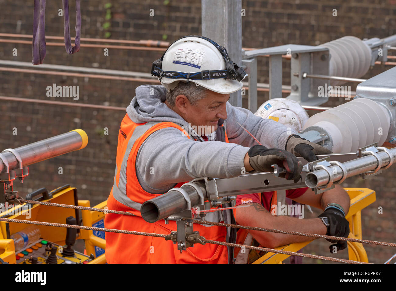 Newbury, Berkshire, UK. 28th August 2018. Newbury Station, Berkshire UK. Engineers working on the electrification  of the railway line at Newbury earlier today. The Great Western Railway region is closed in ths area until August 31st. Credit: Peter Titmuss/Alamy Live News - Stock Image