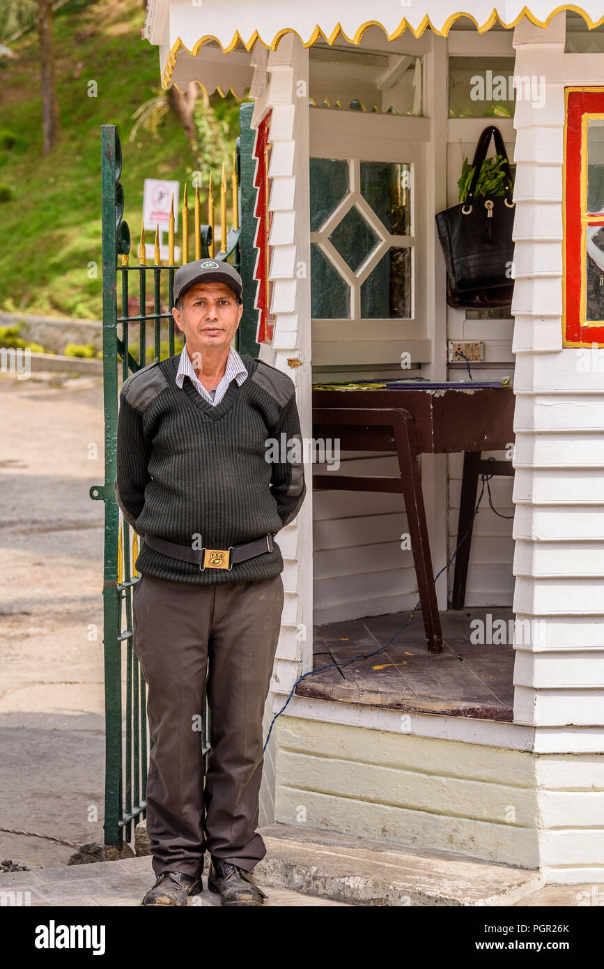 SIKKIM, INDIA - MAR 13, 2017: Unidentified Indian guardian in uniform stands near postoffice and gates. - Stock Image
