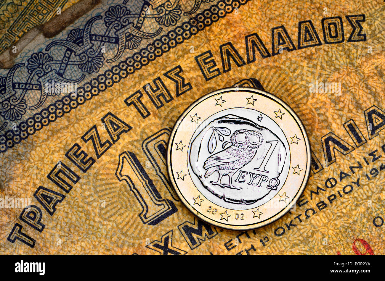 Greek 1 Euro coin on a 1941 1000 Drachma Greek banknote Stock Photo