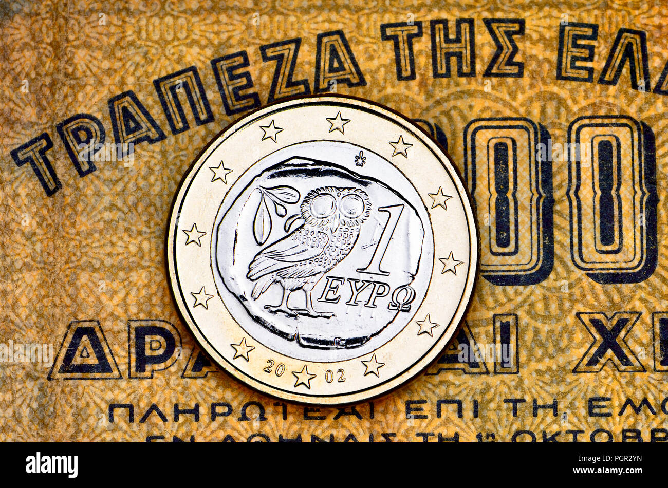 Greek 1 Euro coin on a 1941 1000 Drachma Greek banknote - Stock Image