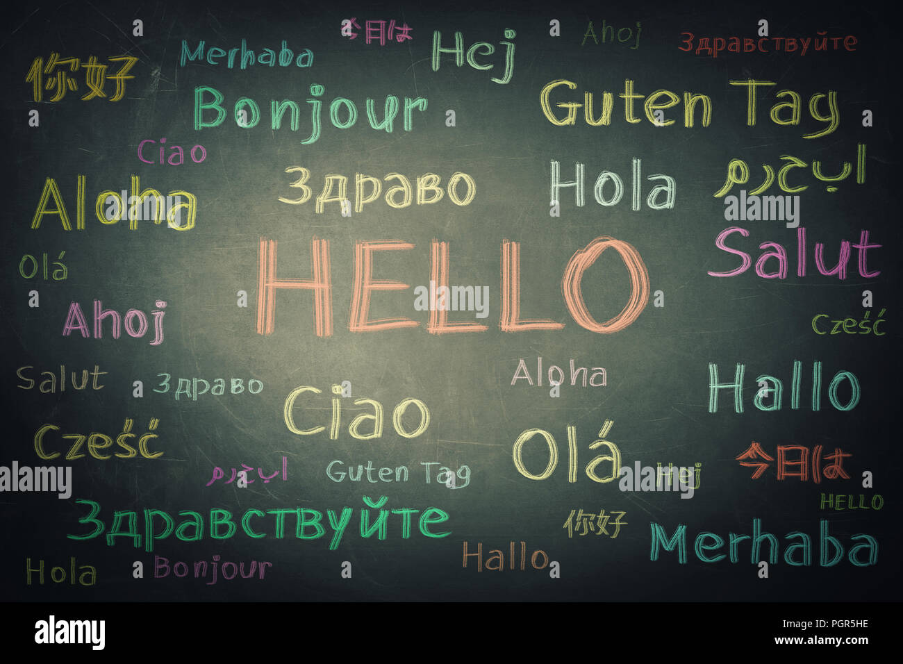 Blackboard background chalk written with the word hello in different languages and colors. Opportunity for learning many languages for students. - Stock Image