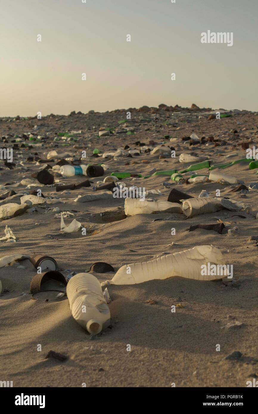 A beach that is littered with plastic waste, plastic bottles, on a beach clean at Marsa Nakari, Egypt. - Stock Image