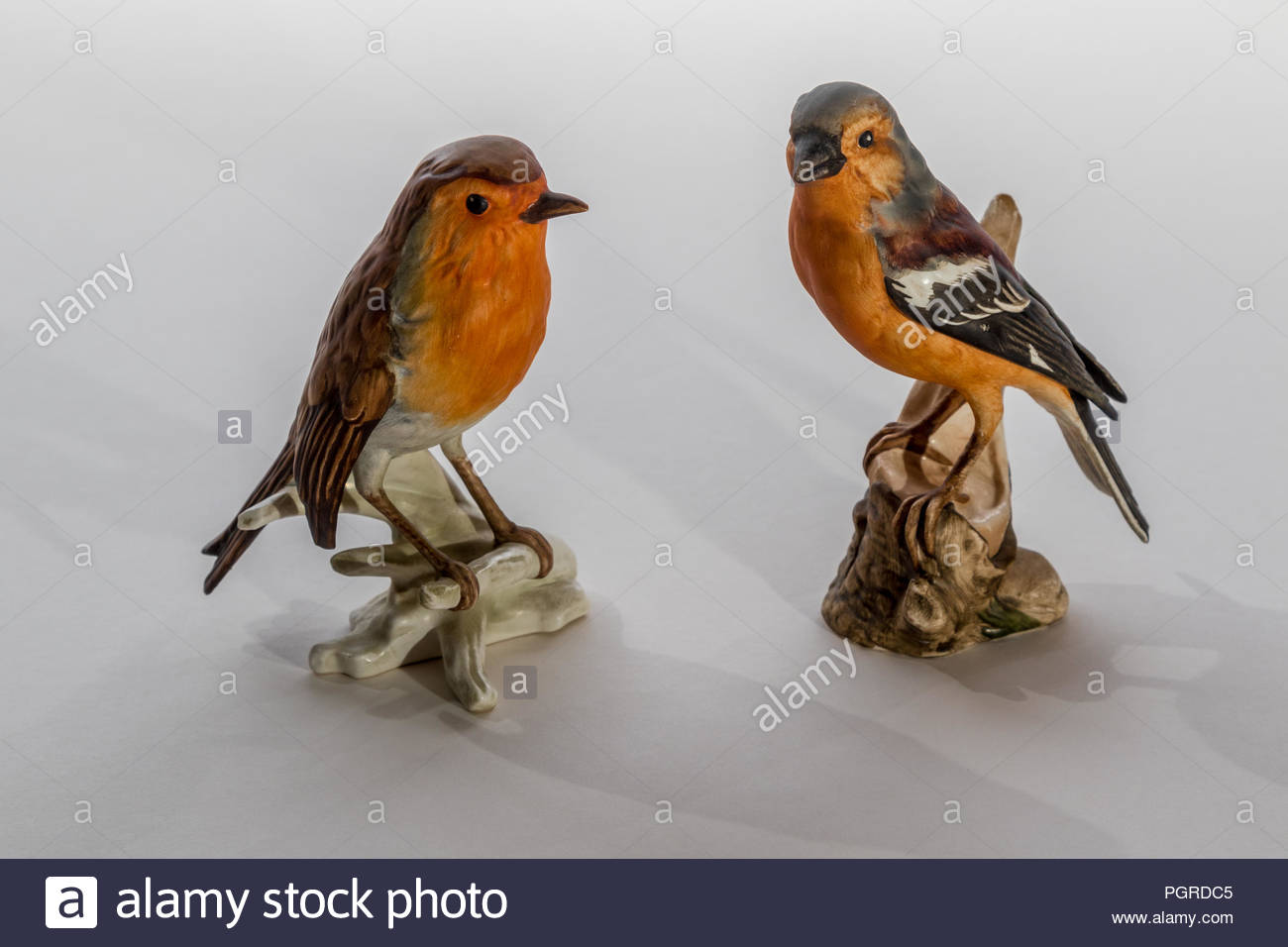 Goebel porcelain bird ornaments manufactured in West Germany in the 1970's on a white background. - Stock Image