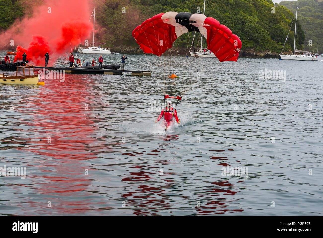 24/08/2018, Fowey, Cornwall, UK. Parachute diplay team The Red Devils make a low level jump into the Fowey River estuary at The Fowey Royal Regatta - Stock Image