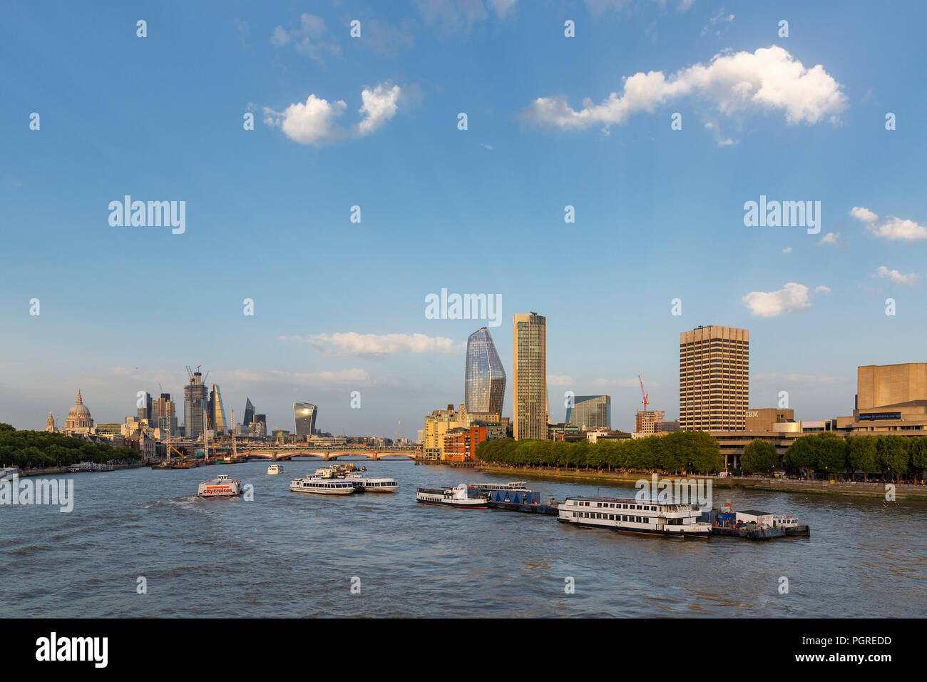 LONDON, UK - AUGUST 6, 2018 :  Boats on the River Thames by Waterloo Bridge with the Southbank centre, Blackfriars Bridge, St Paul's and city skyscrap Stock Photo
