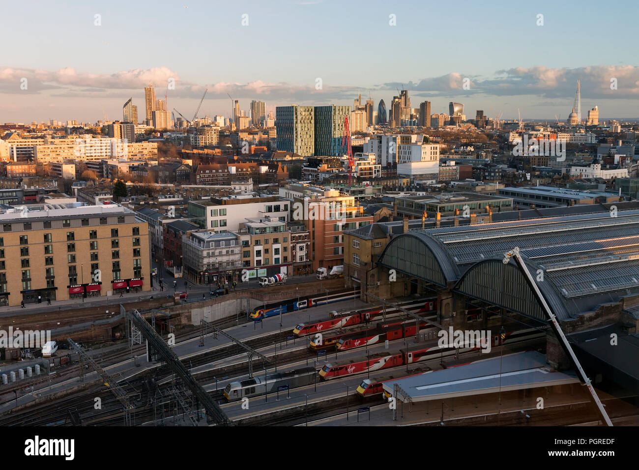 LONDON, UK - MARCH 7, 2018 : High, wide, daytime view of  London's skyline, with King's Cross Station in the foreground and the city landmarks in the  - Stock Image