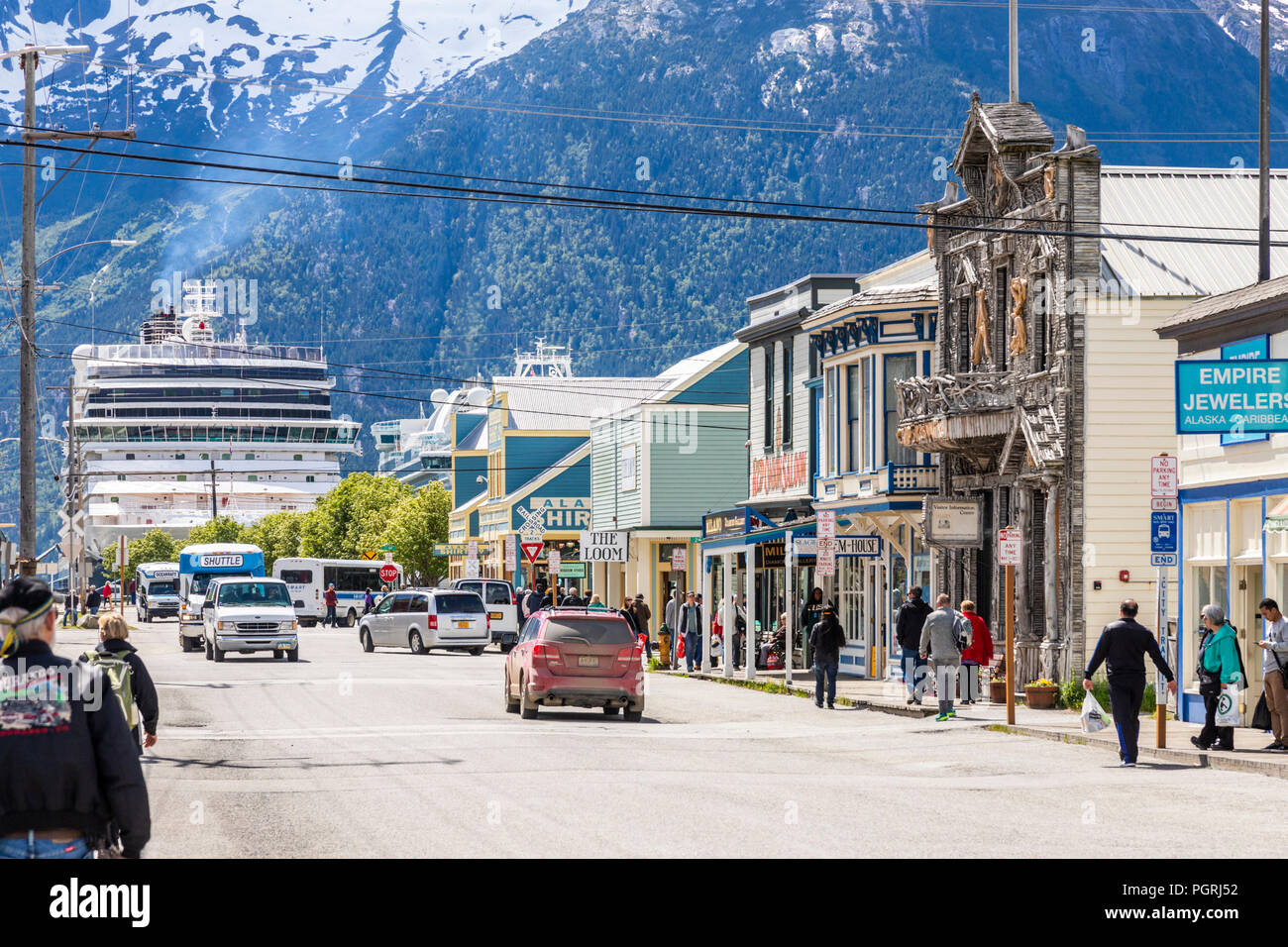 Cruise liners in the harbour very close to the tourist shops in the main street in Skagway, Alaska USA - Stock Image