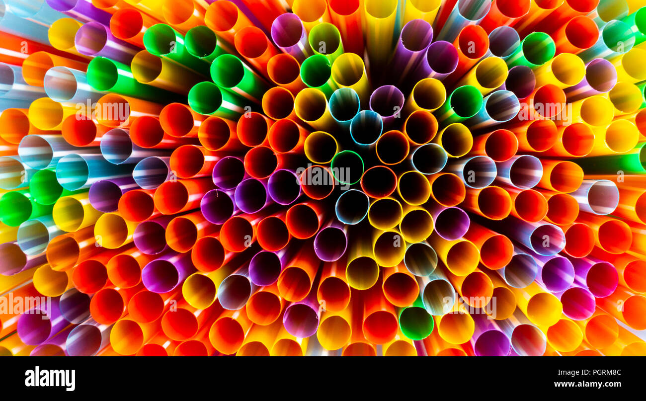 Colourful plastic drinking straws. Plastic pollution concept. - Stock Image