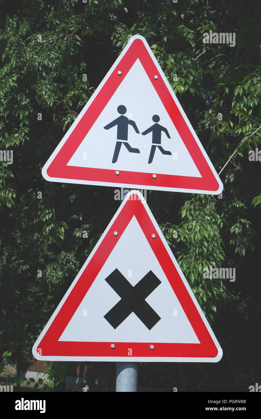 Traffic signs, School Ahead and Crossroads, Wekerle, Kispest, Budapest, Hungary - Stock Image